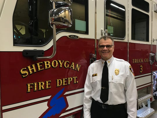 Mike Romas, chief, stands next to the Sheboygan Fire Department's new truck.