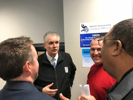 LHSAA Executive Director Eddie Bonine visits with North DeSoto coach Scott Abernathy and Arcadia principal Jeff Sampson Tuesday in Shreveport. Bonine visited Pineville High School Wednesday to meet with Cenla coaches and principals.