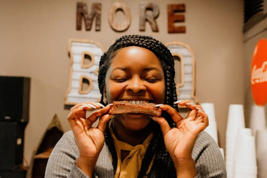 Boom or Bust Byway blogger Shalisa Roland enjoys the ribs at Uncle Henry's Smokehouse BBQ in Benton.