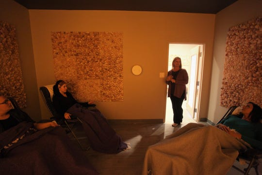 Breathe Salt Vault Owner Kim Gardener explains the process of a salt therapy session to a group.
