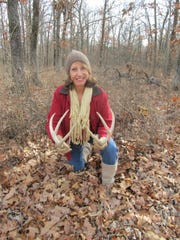 Donna White with some of the shed antlers she found. Starting this month, bucks start shedding their antlers.