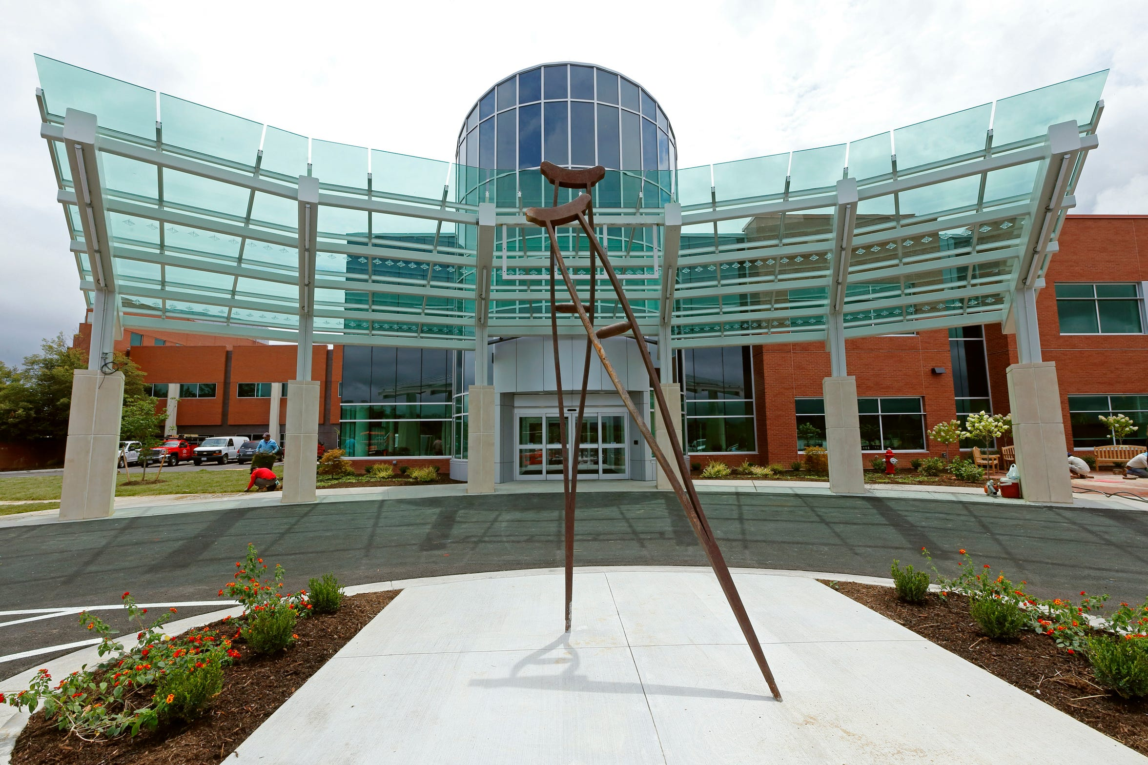 The crutches' sculpture created by the late Staunton sculptor Willy Ferguson, was re-installed outside the new entrance of Augusta Health's Emergency Department in Fishersville, Virginia.