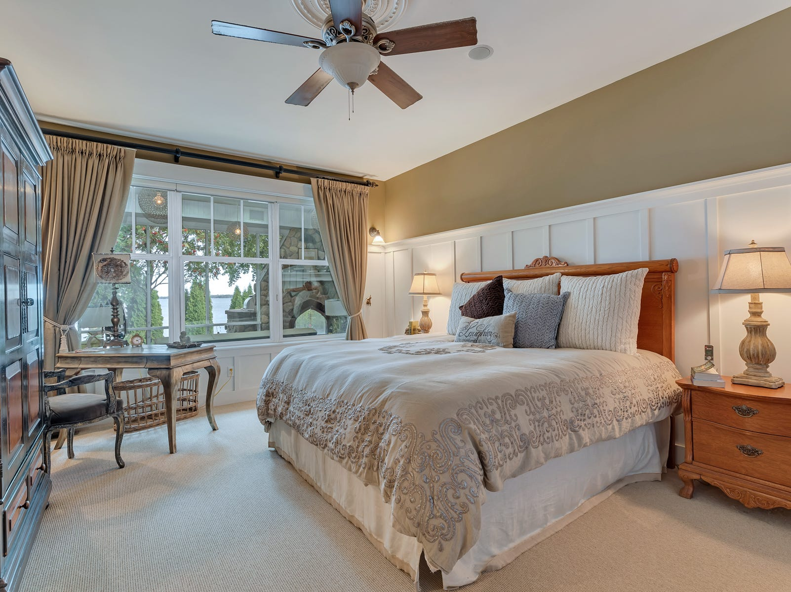 The master bedroom sits on the main level and looks out to the waterfront.