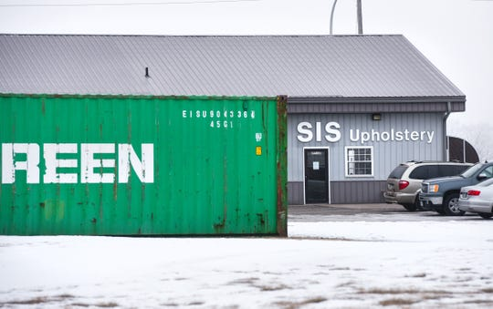 Three large shipping containers sit on the lot at Sis Auto & Furniture Upholstery Tuesday, Jan. 15, at 6601 Stearns County Road 47, St. Augusta.