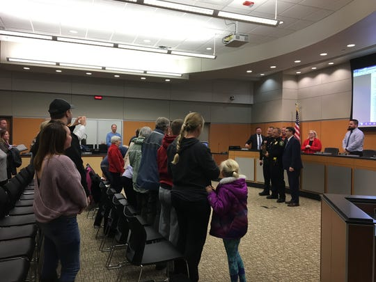 Sauk Rapids Police Officer John Zwack is honored in retirement with a standing ovation Monday, Jan. 14, 2019.