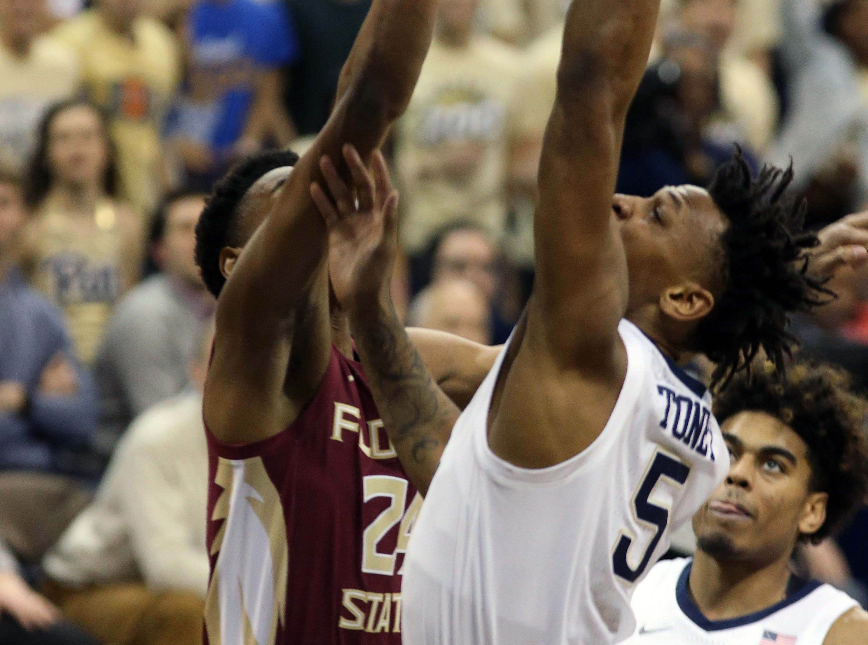 Jan 14, 2019; Pittsburgh, PA, USA; Pittsburgh Panthers guard Au'Diese Toney (5) shoots against Florida State Seminoles guard Devin Vassell (24) during the first half at the Petersen Events Center. Mandatory Credit: Charles LeClaire-USA TODAY Sports
