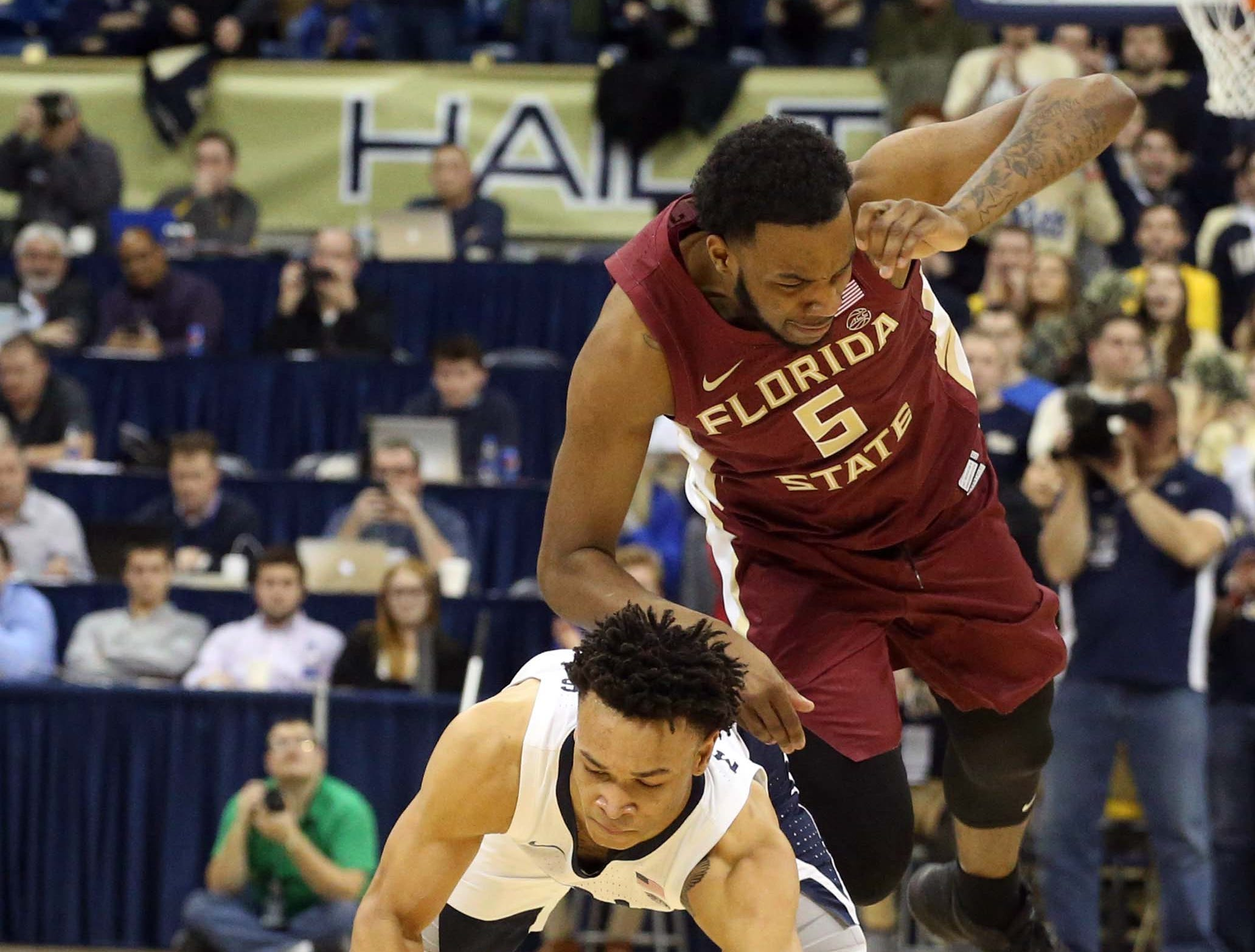 Jan 14, 2019; Pittsburgh, PA, USA; Pittsburgh Panthers guard Trey McGowens (bottom) is fouled by Florida State Seminoles guard PJ Savoy (5) during the second half at the Petersen Events Center. Pittsburgh won 75-62. Mandatory Credit: Charles LeClaire-USA TODAY Sports