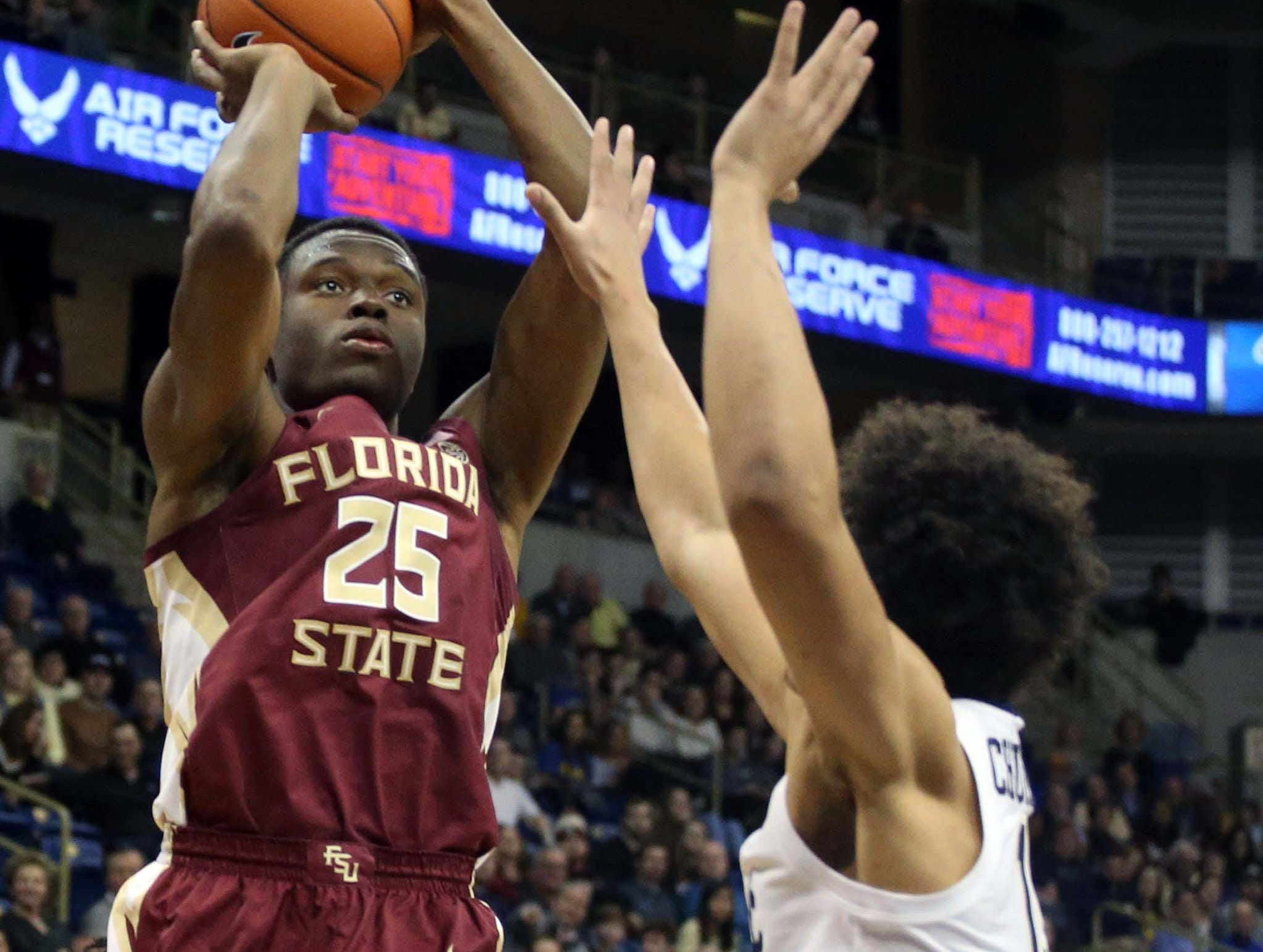 Jan 14, 2019; Pittsburgh, PA, USA; Florida State Seminoles forward Mfiondu Kabengele (25) shoots against Pittsburgh Panthers forward Kene Chukwuka (right) during the first half at the Petersen Events Center. Mandatory Credit: Charles LeClaire-USA TODAY Sports