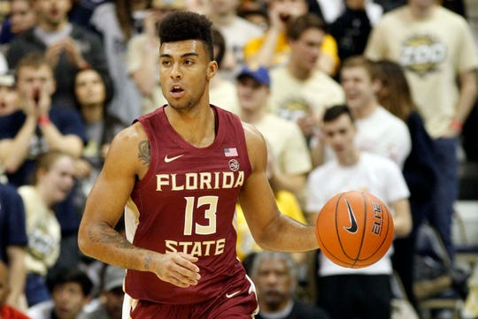 Jan 14, 2019; Pittsburgh, PA, USA; Florida State Seminoles guard Anthony Polite (13) brings the ball up court against the Pittsburgh Panthers during the first half at the Petersen Events Center. Mandatory Credit: Charles LeClaire-USA TODAY Sports