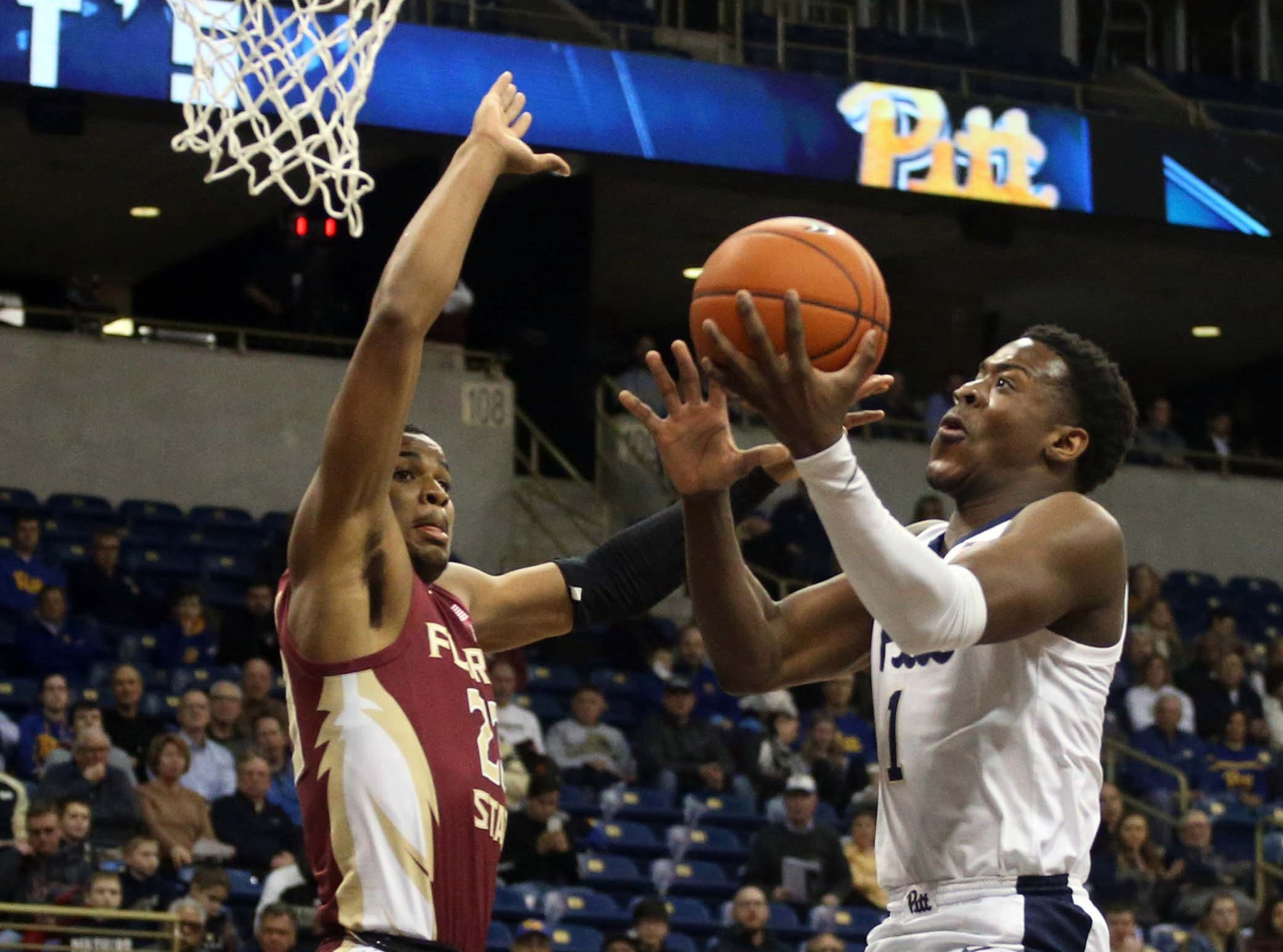 Jan 14, 2019; Pittsburgh, PA, USA; Pittsburgh Panthers guard Xavier Johnson (1) shoots against Florida State Seminoles guard M.J. Walker (23) during the first half at the Petersen Events Center. Mandatory Credit: Charles LeClaire-USA TODAY Sports