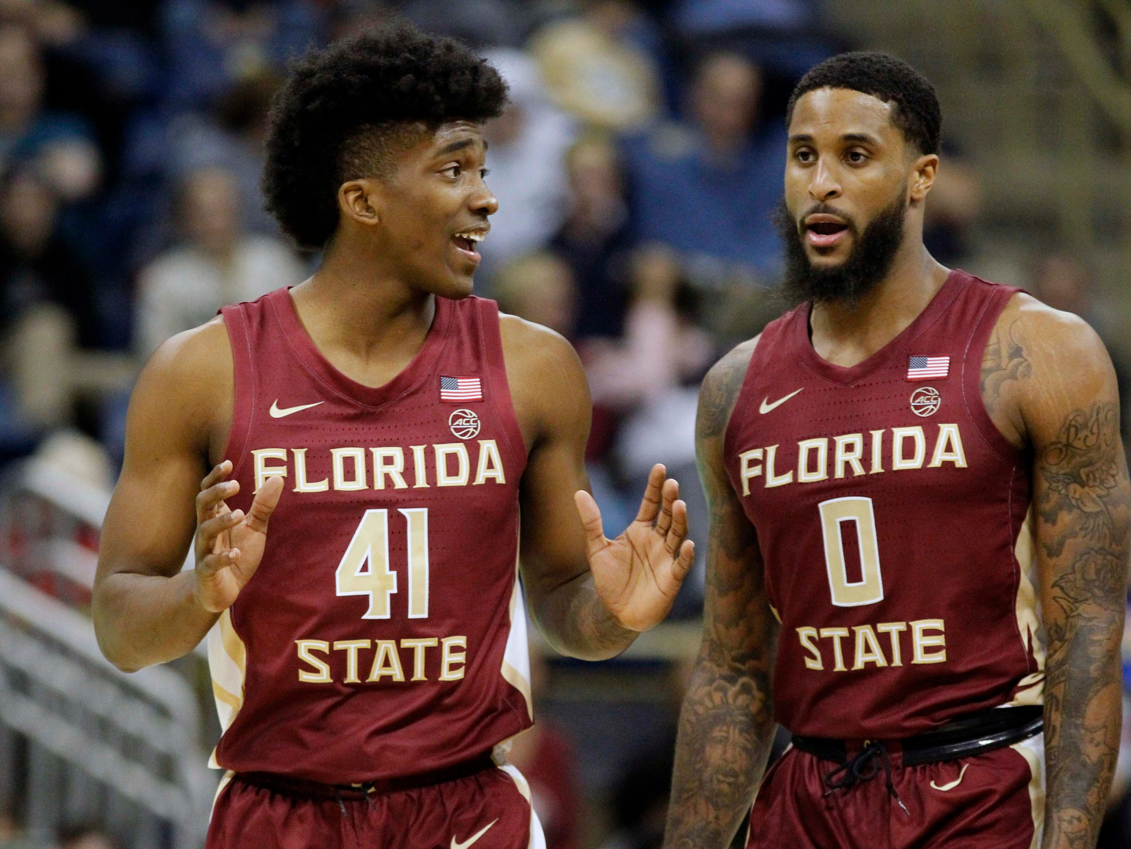 Jan 14, 2019; Pittsburgh, PA, USA; Florida State Seminoles guard Terance Mann (wearing 41) talks with forward Phil Cofer (0) against the Pittsburgh Panthers during the second half at the Petersen Events Center. Pittsburgh won 75-62. Mandatory Credit: Charles LeClaire-USA TODAY Sports