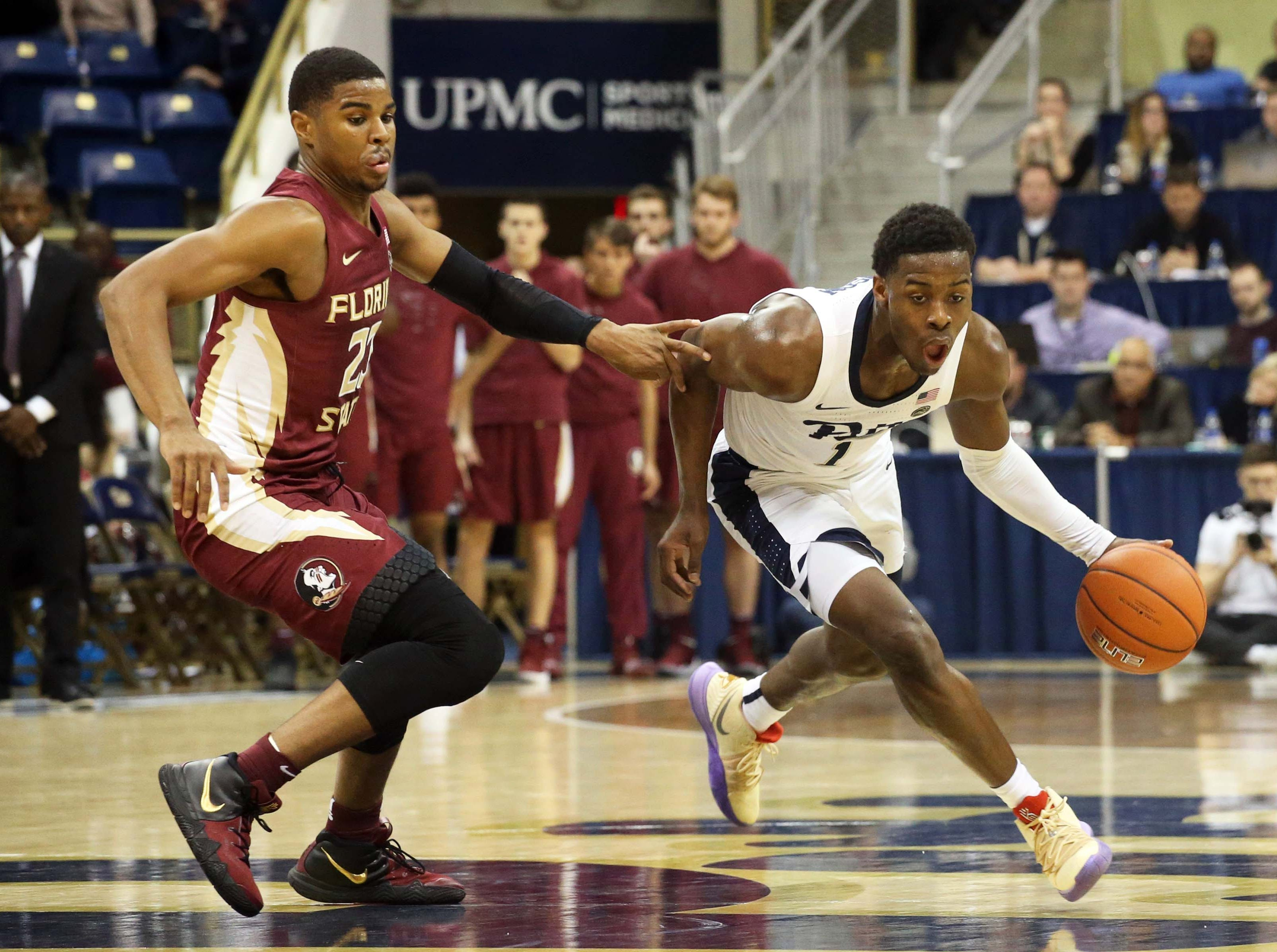 Jan 14, 2019; Pittsburgh, PA, USA; Pittsburgh Panthers guard Xavier Johnson (1) dribbles the ball around Florida State Seminoles guard M.J. Walker (23) during the second half at the Petersen Events Center. Pittsburgh won 75-62. Mandatory Credit: Charles LeClaire-USA TODAY Sports