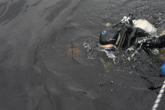 Aucilla Research Institute staff member Tom Harmon prepares to scuba dive eight feet down to the bottom of the Wakulla River to observe the remains of a mastodon Monday, Jan. 14, 2019.