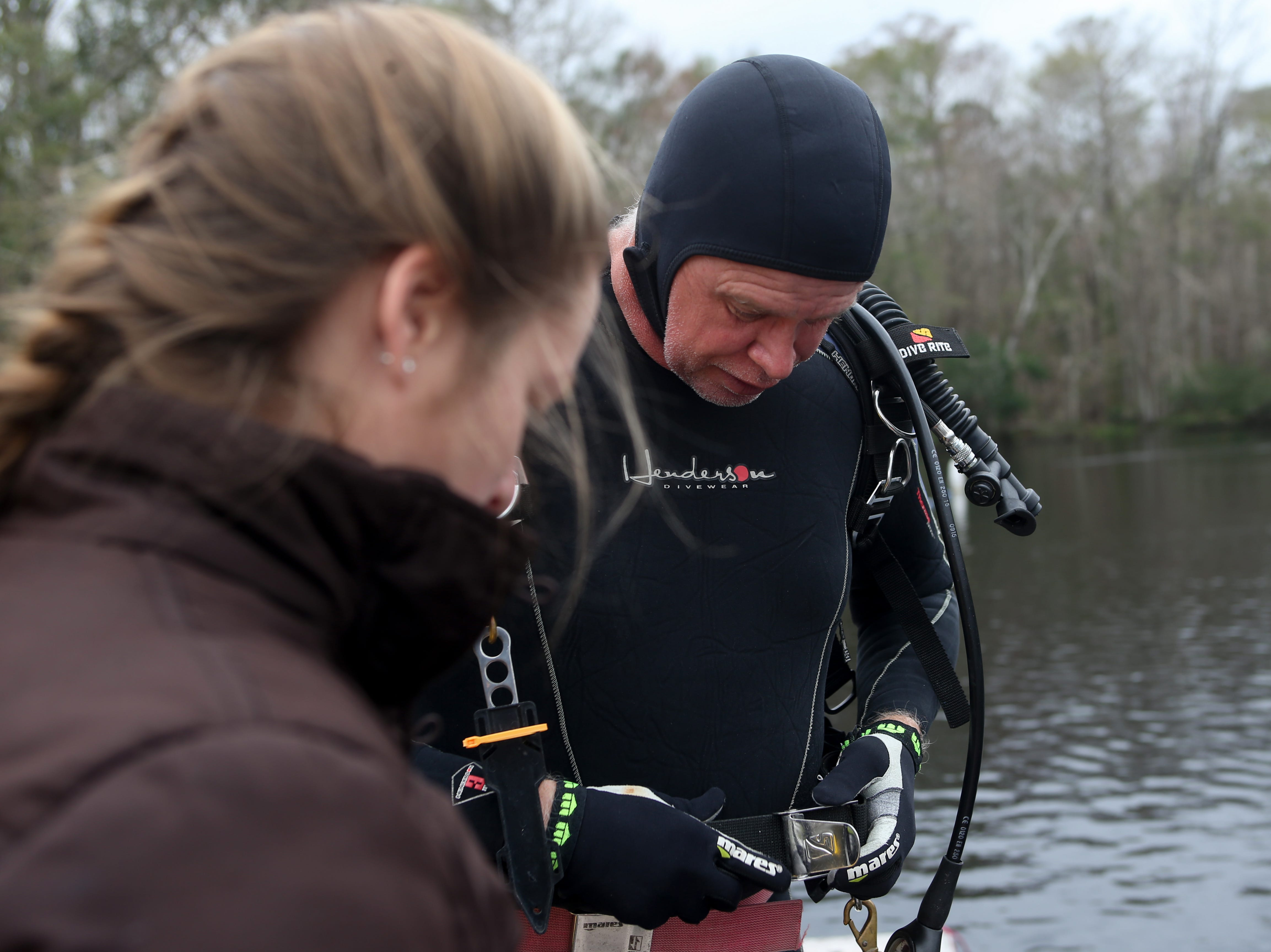 Co-principal Investigator Andy Hemmings prepares to scuba dive to the bottom of the Wakulla River to observe the remains of a mastodon Monday, Jan. 14, 2019.