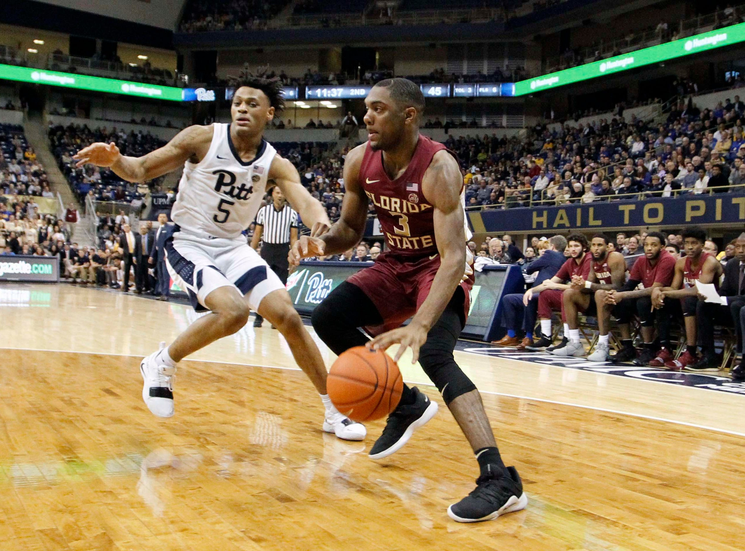 Jan 14, 2019; Pittsburgh, PA, USA; Florida State Seminoles guard Trent Forrest (3) dribbles the ball against Pittsburgh Panthers guard Au'Diese Toney (5) during the second half at the Petersen Events Center. Pittsburgh won 75-62. Mandatory Credit: Charles LeClaire-USA TODAY Sports