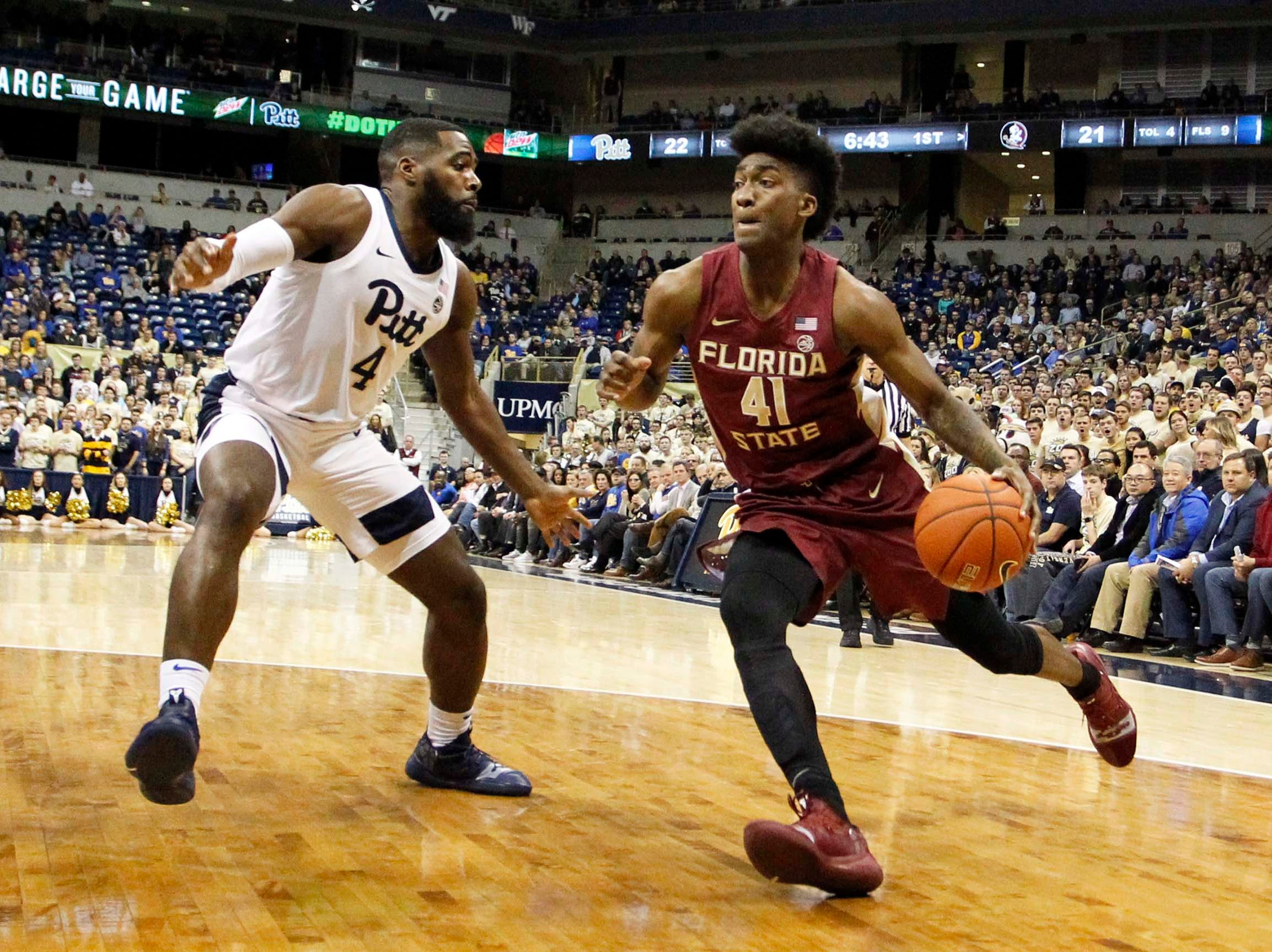Jan 14, 2019; Pittsburgh, PA, USA; Florida State Seminoles guard Terance Mann (wearing 41) drives to the basket against Pittsburgh Panthers guard Jared Wilson-Frame (4) during the first half at the Petersen Events Center. Mandatory Credit: Charles LeClaire-USA TODAY Sports