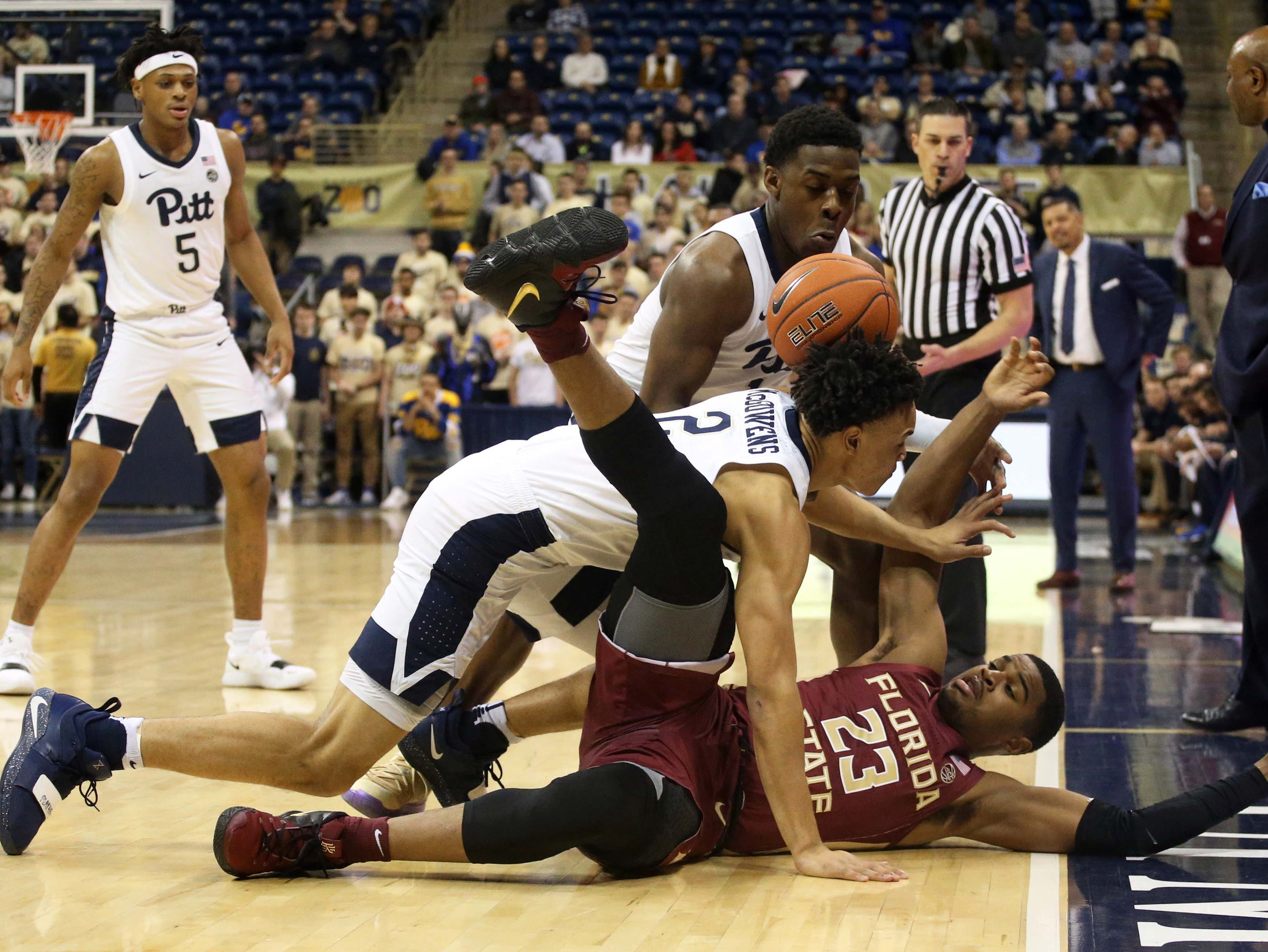 Jan 14, 2019; Pittsburgh, PA, USA; Pittsburgh Panthers guard Xavier Johnson (top) and guard Trey McGowens (2) steal the ball from Florida State Seminoles guard M.J. Walker (23) during the first half at the Petersen Events Center. Mandatory Credit: Charles LeClaire-USA TODAY Sports