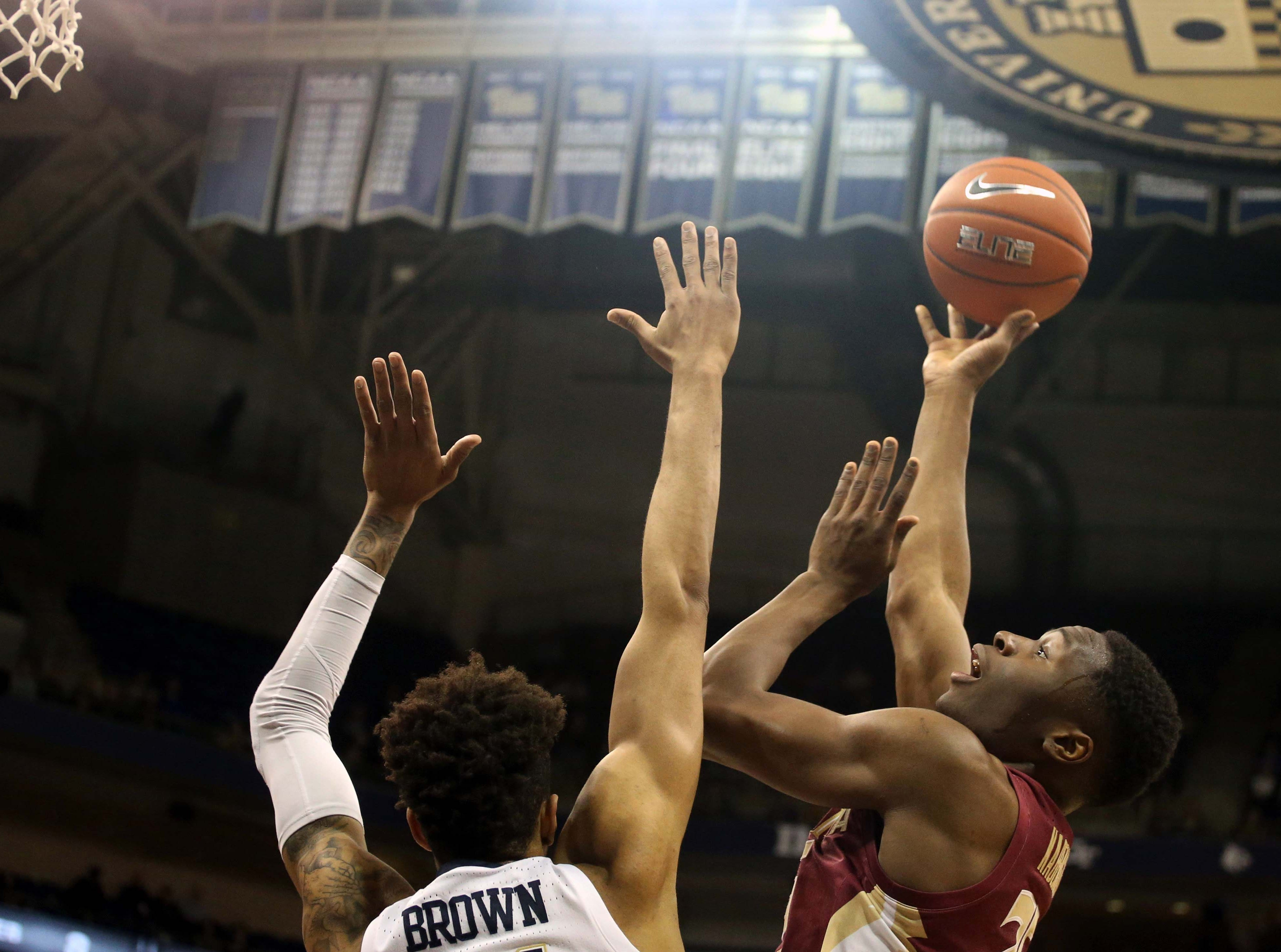 Jan 14, 2019; Pittsburgh, PA, USA; Florida State Seminoles forward Mfiondu Kabengele (25) shoots against Pittsburgh Panthers forward Terrell Brown (21) during the first half at the Petersen Events Center. Mandatory Credit: Charles LeClaire-USA TODAY Sports