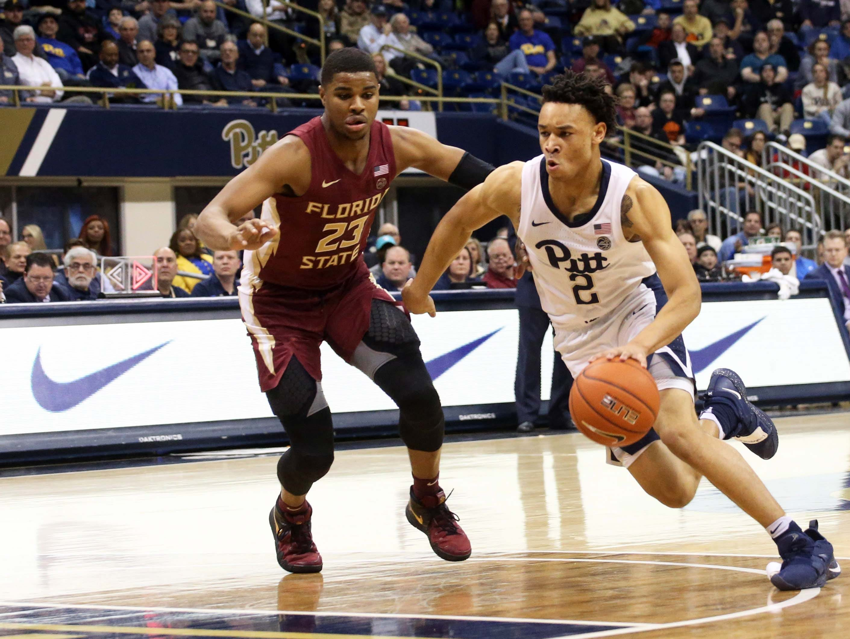 Jan 14, 2019; Pittsburgh, PA, USA; Pittsburgh Panthers guard Trey McGowens (2) drives to the basket against Florida State Seminoles guard M.J. Walker (23) during the second half at the Petersen Events Center. Pittsburgh won 75-62. Mandatory Credit: Charles LeClaire-USA TODAY Sports