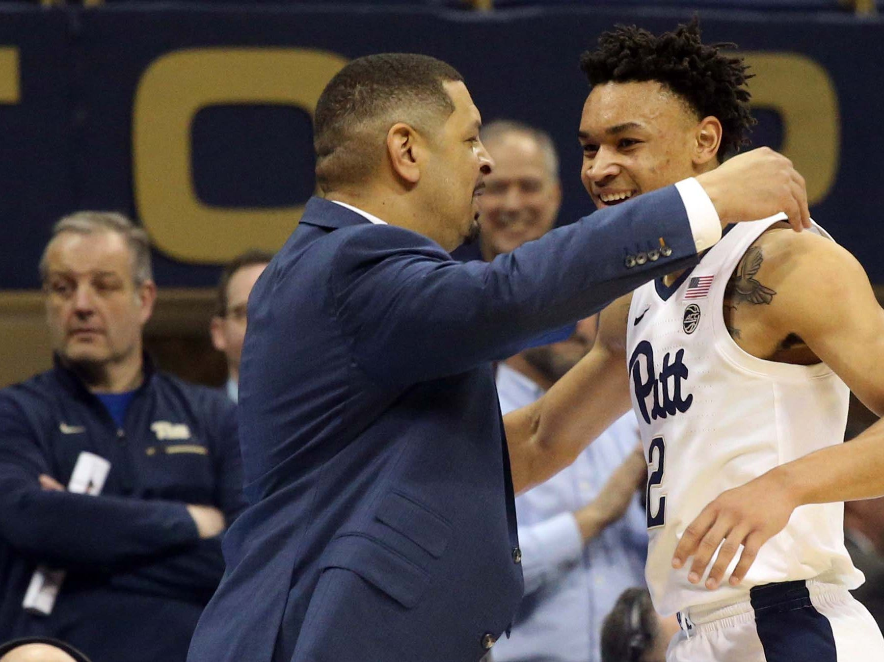 Jan 14, 2019; Pittsburgh, PA, USA; Pittsburgh Panthers head coach Jeff Capel (left) embraces guard Trey McGowens (2) as he leaves the floor against the Florida State Seminoles during the second half at the Petersen Events Center. Mandatory Credit: Charles LeClaire-USA TODAY Sports