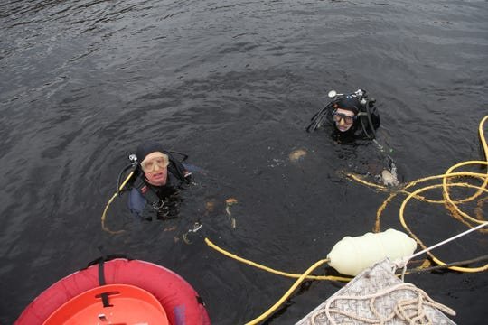 Co-principal Investigator Andy Hemmings and Aucilla Research Institute staff member Tom Harmon prepare to scuba dive to the bottom of the Wakulla River to observe the remains of a mastodon Monday, Jan. 14, 2019.