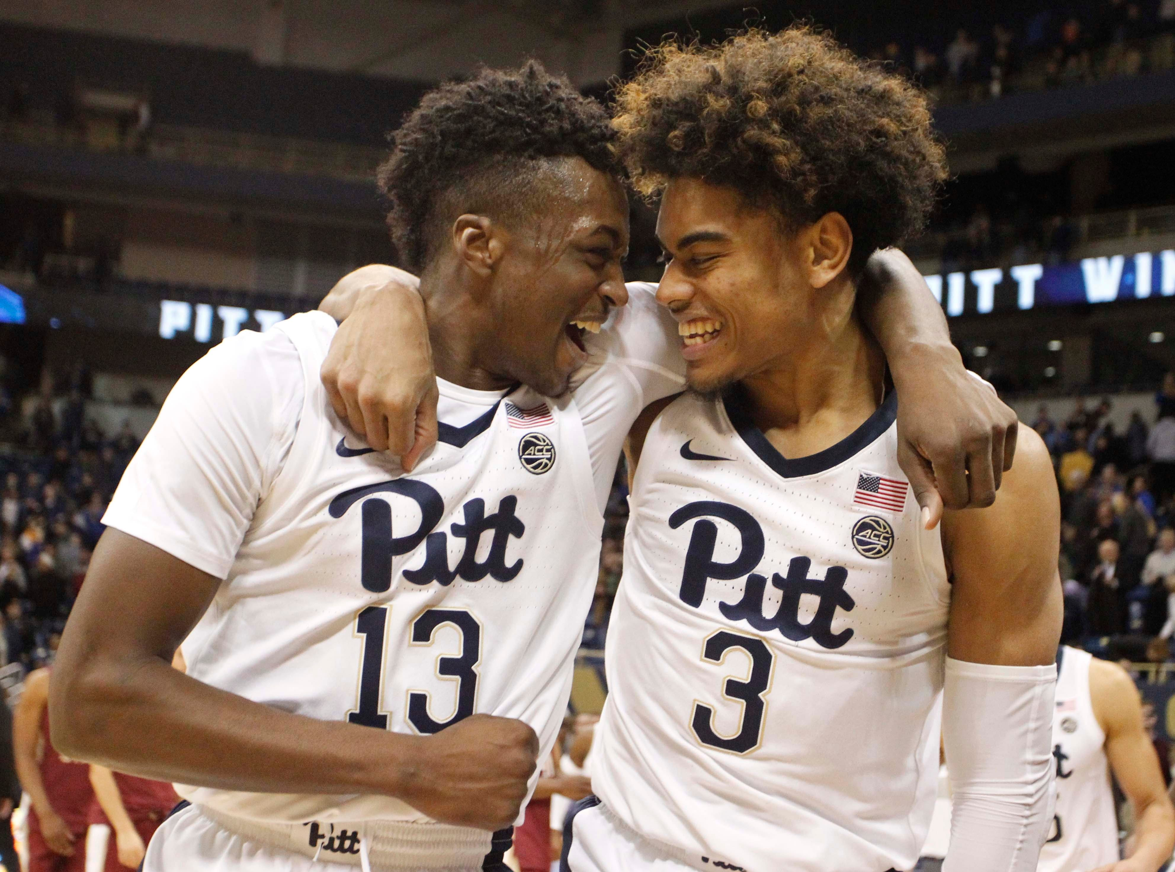 Jan 14, 2019; Pittsburgh, PA, USA;  Pittsburgh Panthers guard Khameron Davis (13) and guard Malik Ellison (3) celebrate after defeating the Florida State Seminoles at the Petersen Events Center. Pittsburgh won 75-62. Mandatory Credit: Charles LeClaire-USA TODAY Sports