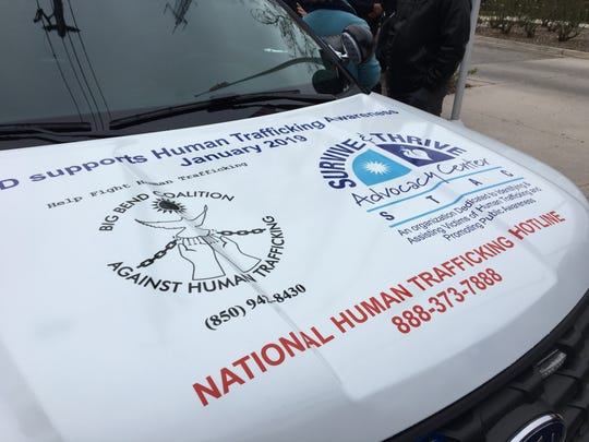 Tallahassee Police Department's downtown cop car decal for Human Trafficking Awareness Month.