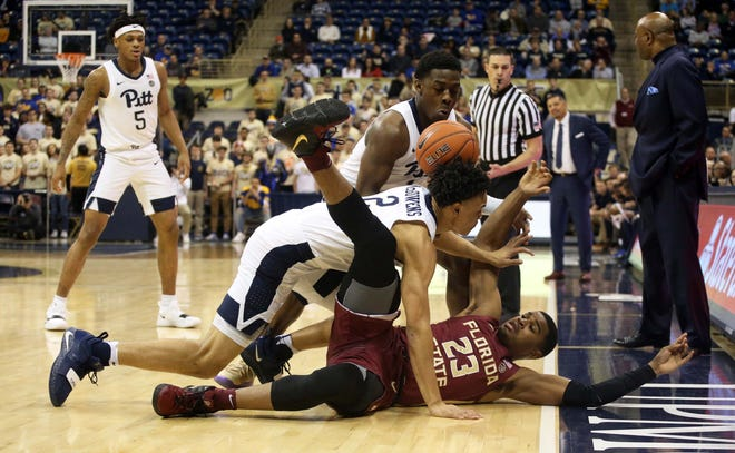 Pittsburgh Panthers guard Xavier Johnson (top) and guard Trey McGowens (2) steal the ball from Florida State Seminoles guard M.J. Walker (23) during the first half at the Petersen Events Center.