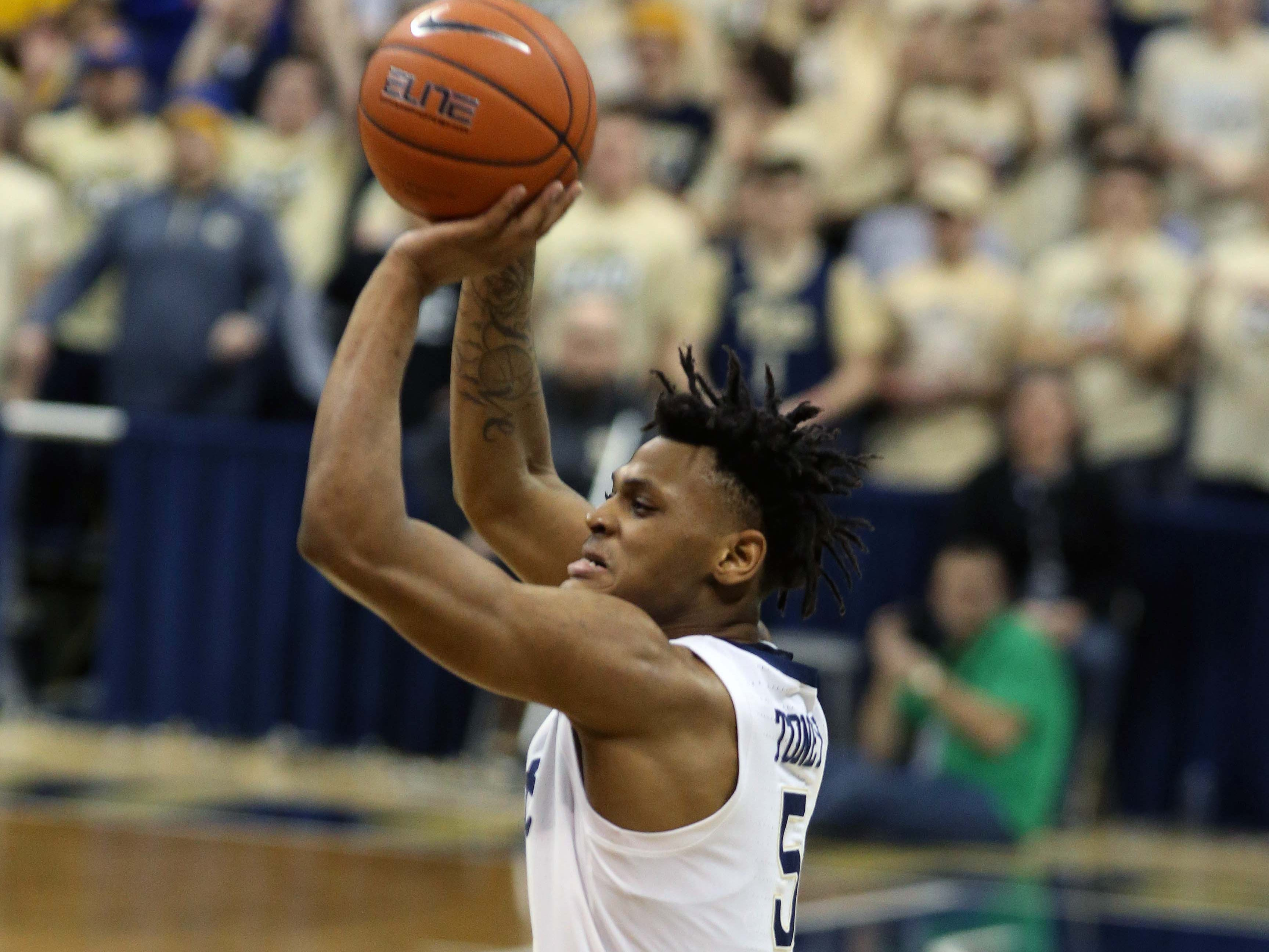Jan 14, 2019; Pittsburgh, PA, USA; Pittsburgh Panthers guard Au'Diese Toney (5) shoots a three point basket against the Florida State Seminoles during the first half at the Petersen Events Center. Mandatory Credit: Charles LeClaire-USA TODAY Sports