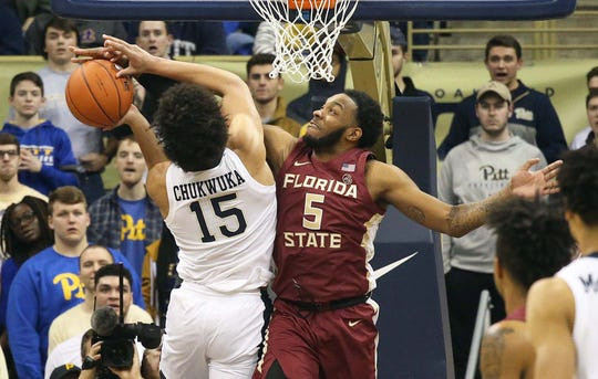 Jan 14, 2019; Pittsburgh, PA, USA; Florida State Seminoles guard PJ Savoy (5) fouls Pittsburgh Panthers guard Khameron Davis (13) while defending during the second half at the Petersen Events Center. Pittsburgh won 75-62. Mandatory Credit: Charles LeClaire-USA TODAY Sports