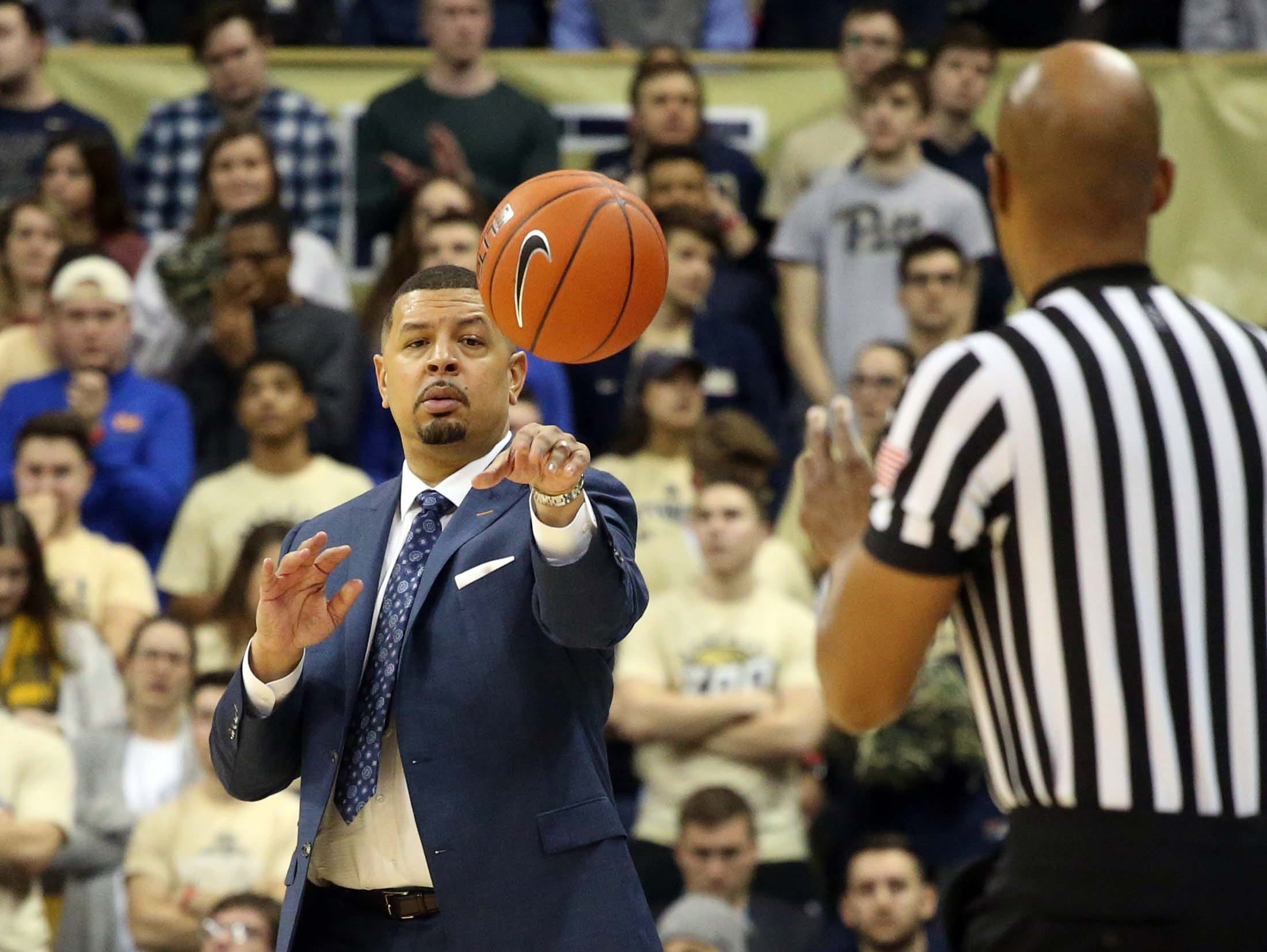 Jan 14, 2019; Pittsburgh, PA, USA; Pittsburgh Panthers head coach Jeff Capel  returns loose ball to the official against the Florida State Seminoles during the second half at the Petersen Events Center. Pittsburgh won 75-62. Mandatory Credit: Charles LeClaire-USA TODAY Sports