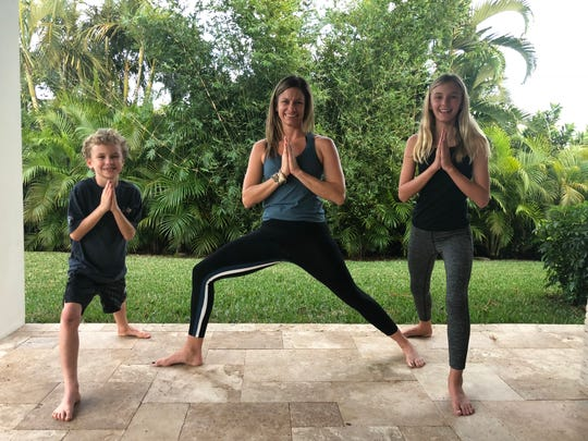 Amanda Steadman says yoga is a great exercise for moms, helping to strengthen both mind and body. Here, she teaches her children Ty and Ava some basic moves.