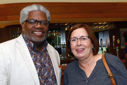 Kevin Singletary, of Roundtable of St. Lucie County, left, with Julie Summers  of Sarah's Kitchen at the Council of Social Agencies of St. Lucie's annual luncheon and officer installation.