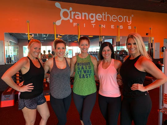 Nicole Dugan (center) joined friends Liz Smith, Lindsay Naffziger, Erin Graul, and Kim Baudo at Orange Theory Fitness.