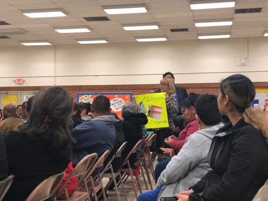 Angela Harris, cafeteria manager at Douglass Elementary, speaks to EPISD officials during a community meeting on proposed school closures Monday in South-Central El Paso.