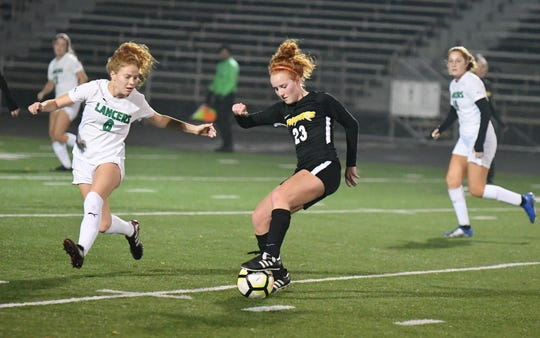 Senior Fiona Wyrick, defended by Thousand Oaks' Ally Mosher in a recent Marmonte League game, makes up the Newbury Park High girls soccer team's All-Fiona central midfield partnership with senior Fiona Marangola.