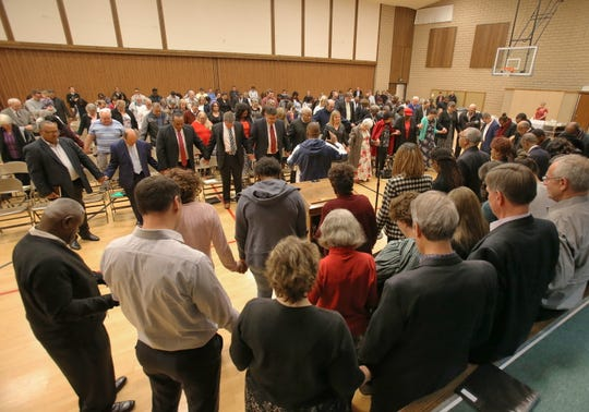 The group gathered for the Martin Luther King Jr. observance in 2019 holds hands and says the final prayer. This year's event will be Jan. 20 in Oxnard.