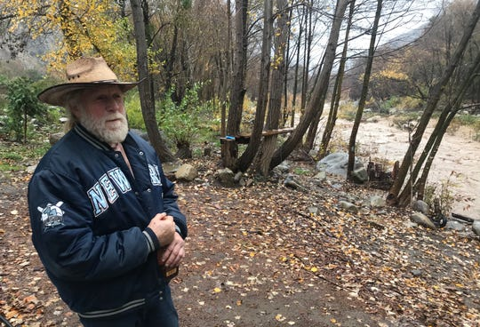 Ken Whitteker, who lives in Matilija Canyon, despite the rain storms coming through the area. The Matilija Canyon Creek was rising behind his property.