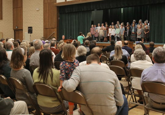 """Guests listen to the children's choir of Camarillo's Church of Jesus Christ of Latter-day Saints as it performs during the """"We Are One"""" event Saturday at the church."""
