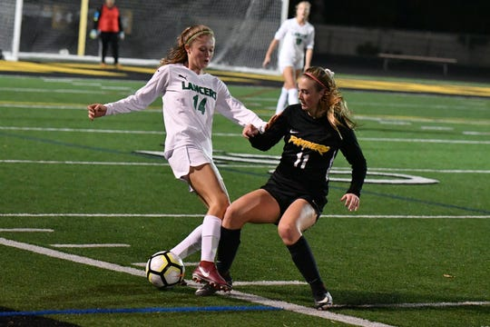 Newbury Park's Kaitlyn McKeown, right, battles with Thousand Oaks' Ireland Nowak during a recent Marmonte League match.  McKeown, a Navy commit, leads unbeaten Newbury Park with 14 goals in 14 matches.