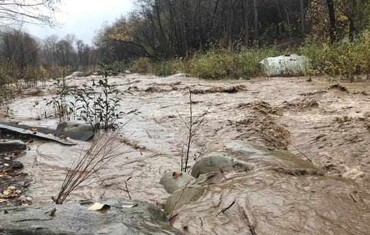 Matilija Canyon Creek was rising behind Ken Whitteker's property in Matilija Canyon as a series of storms hit Ventura County. Despite mandatory evacuation orders, Whitteker said Tuesday he was not going to evacuate.