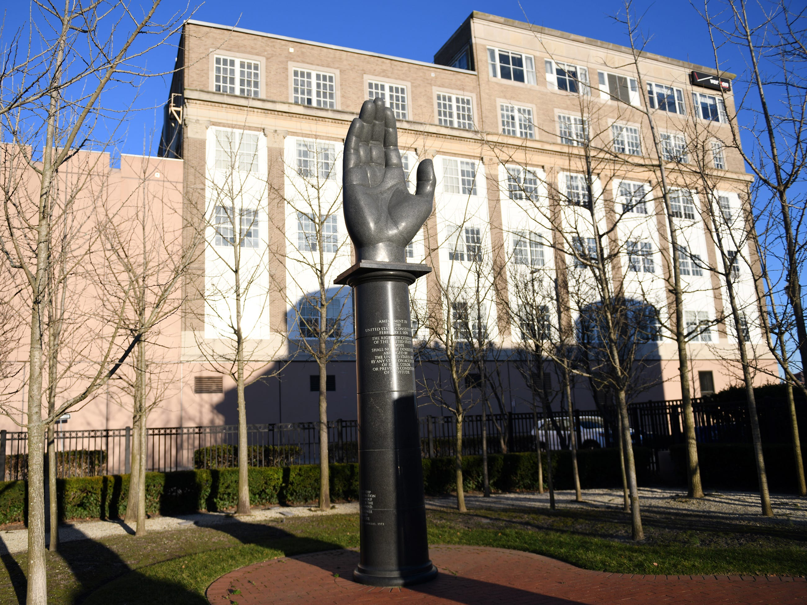 A upraised hand sits atop a black granite column, quarried in Africa, within The Civil Rights Garden in Atlantic City. The hand symbolizes the democratic right to vote and for all Americans to participate in the electoral process.