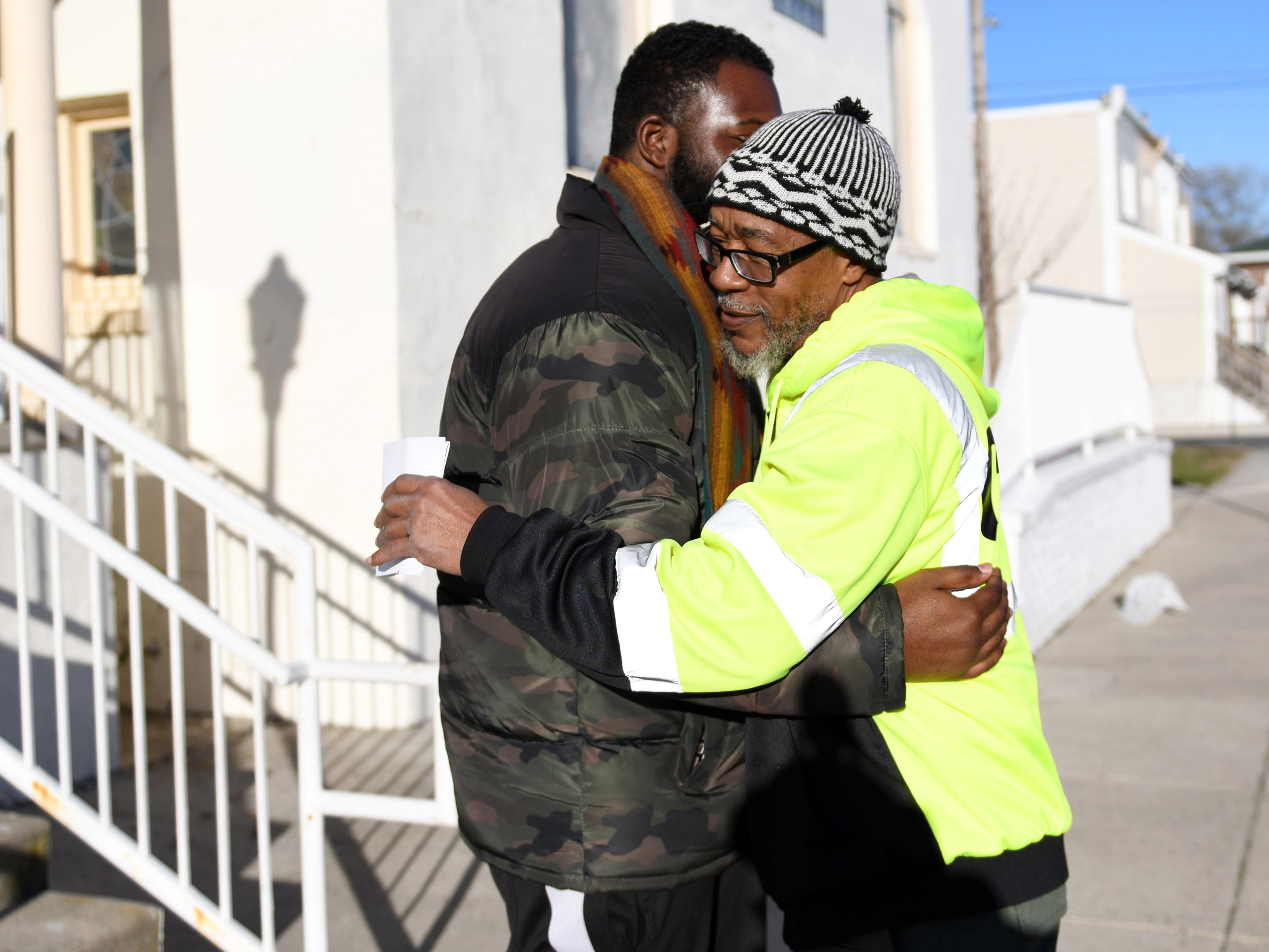 Mr. Safeeullah Muhammad (right) gives a friend a hug outside Allen AME Church on Leeds Avenue in Atlantic City on Friday, Jan. 11, 2019. Muhammad has lived on Dr. Martin Luther King Jr. Boulevard for 17 years.