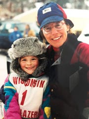 Jan Bootz-Dittman's daughters Jenna and Jayme Dittman started mushing when they were small girls. Here Jenna poses for a photo with Jan.