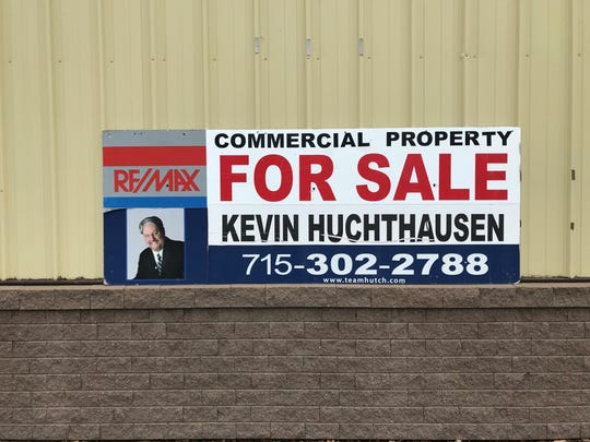 A  for-sale sign on the building at 316 Sherman Street.