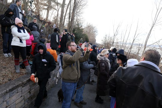 Spectators wait at the Riverwalk to get a view of the demolition of the eastern portion of the Tappan Zee Bridge Jan. 15, 2019 in Tarrytown.