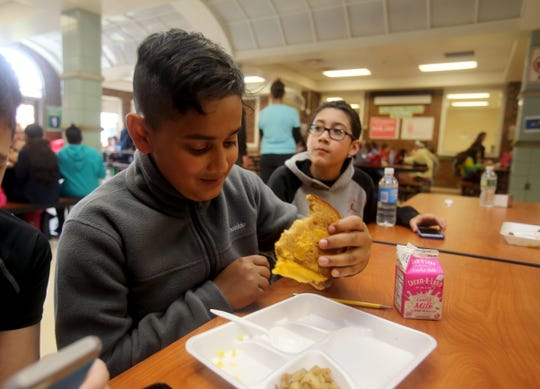 Vivek Mathews, then a sixth-grader at Suffern Middle School, eating a grilled cheese sandwich in May 2017.