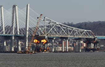 The eastern section of the Tappan Zee Bridge center span crashes into the Hudson River after explosives are detonated on its supports Jan. 15, 2019.