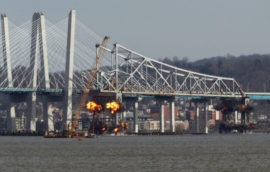 The eastern section of the Tappan Zee Bridge center span is lowered into the Hudson River by explosives Jan. 15, 2019.