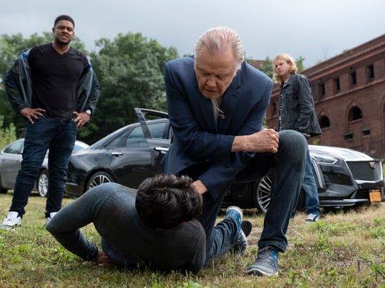 """Pooch Hall as Daryll, Jon Voight as Mickey Donovan, Graham Rogers as Smitty and Chris Tardio as Danny Bianchi (ground) in a scene from Showtime's """"Ray Donovan."""" The Glenwood power plant is in the background."""
